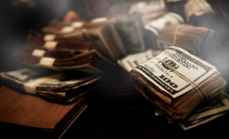 dirty money rolls hundred dollar bills