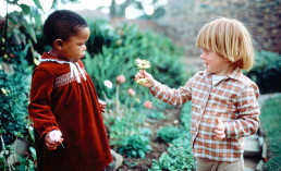 flower children interracial kids playing black white