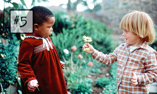 kind children kindness giving flower toddlers black white interracial