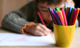child drawing colored markers art