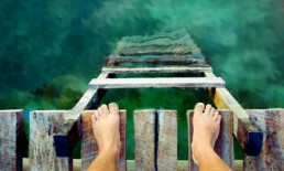 bare feet pier ladder water beach ocean