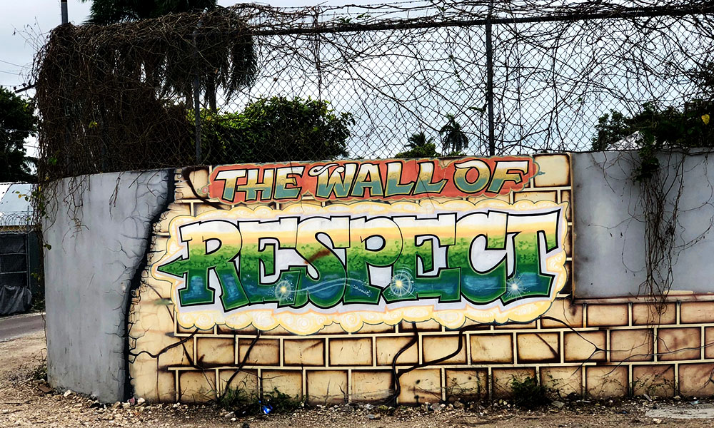 An old wall inland Bahamas is decorated with skilled graffiti: THE WALL OF RESPECT