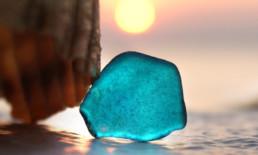The Best Advice So Far: Sea Glass - light blue sea glass on sand against sunset