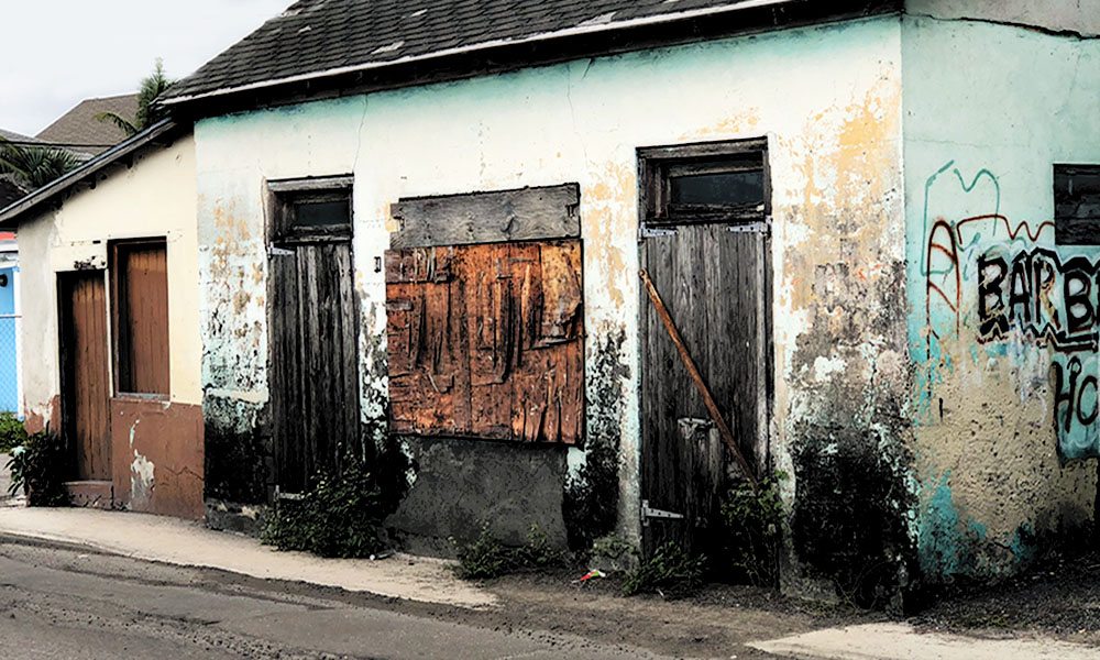 The Best Advice So Far - choice: the wall - dilapidated building inland Bahamas